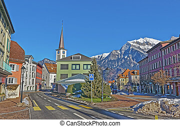 Catholic Church and Mountains in Town of Bad Ragaz. Bad...