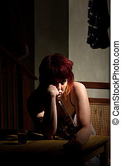 Young woman with near enpty bottle of wine - Underage...