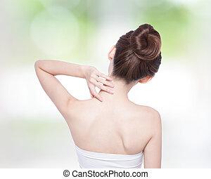 beautiful woman back view - Woman massaging pain back and...