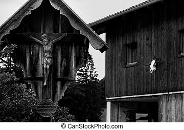 Crucifix with effigy of Christ in front of the house....