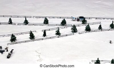 Horse Drawn Sleighs on snowy road in motion layout