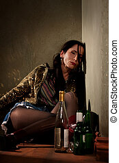 Party Girl - Woman surrounded by booze bottles in a hallway