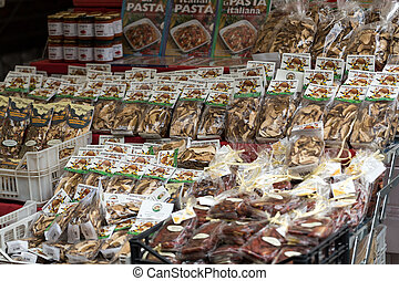 Packaging with colorful and brown pasta on the market Campo...