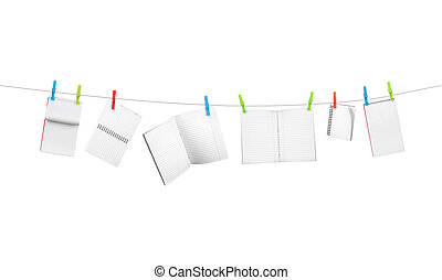 exercise books on the rope isolated on white