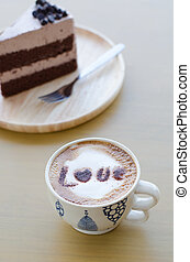 hot coffee with foam milk art love pattern