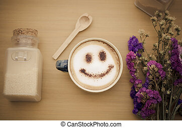 hot coffee with foam milk art smile pattern