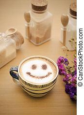 hot coffee with foam milk art smile pattern