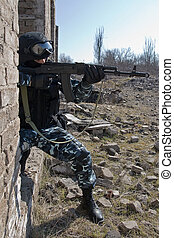 Soldier targeting with an AK-47 rifle - Soldier with an...