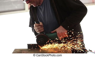Grinding Metal man in shop - Grinding Metal man in metal...
