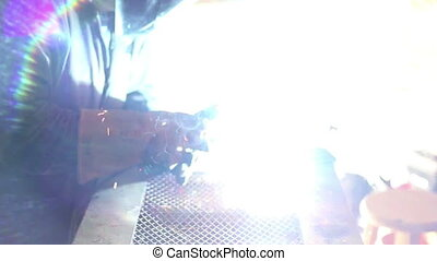 Man welding huge lens flare two