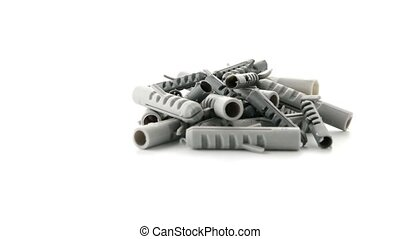 Grey plastic dowels isolated on white background