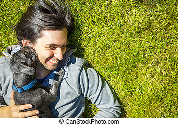 Little Pet Dog and His Owner Having Fun Outdoors - Little...