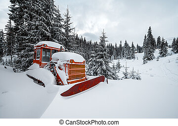 Frozen dozer in high mountains