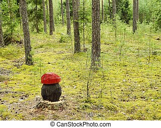 surprize in forest - wooden mushroom in pine forest -...