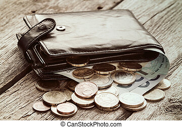 Black wallet with euro currency