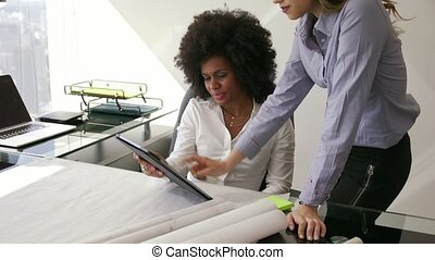 3 Women Colleagues Architect With Tablet PC And Blueprints -...