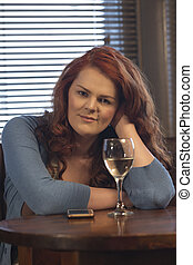 Transgender woman in a pub - Attractive young woman sitting...