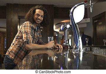 Young man at a bar