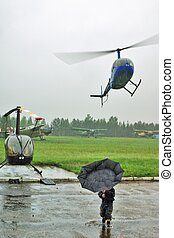 Helicopter launch under a rain - drops fly to camera lenses