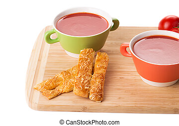Bowl of tomato soup on a white background.