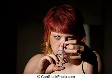 Heroin addict flicking needle - Heroin addict clearing the...