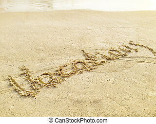 "Inscription ""Vacations"" in the sand on a tropical island,  Maldives."