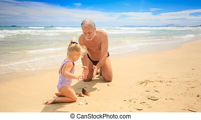Grandpa Little Blond Girl Model Sand Patty on Wet Beach -...
