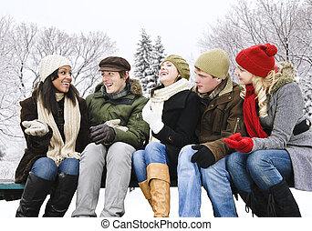 Group of friends outside in winter - Group of young friends...