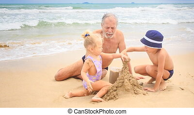 Grandpa Little Blond Girl Boy Build Sand Castle by Hands at Surf