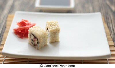 Tasty maki sushi put in a plate - Tasty maki sushi holded by...