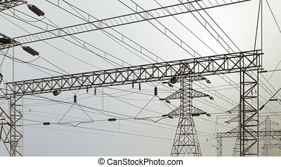 Electricity pylons and lines - Camera moves along high...