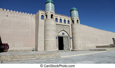 entrance gate in the ancient city wall. Uzbekistan. Khiva. -...