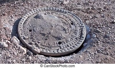 Opened steel manhole cover 2 - Opened steel manhole cover on...