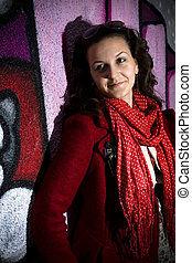 Graffiti art series - Lovely young woman sitting next to a...