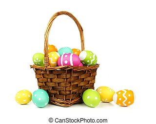 Easter basket filled with colorful eggs on a white...