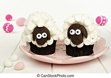 Sheep cupcakes with Easter Eggs - Cute spring sheep cupcakes...