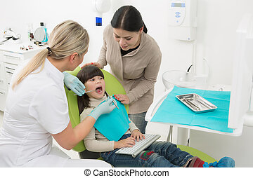 Little girl with her mother at dentist's office - Dentist's...