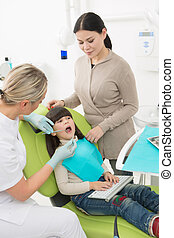 Little girl with her mother at dentist's office - Dentist...