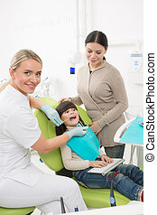 Little girl with her mother at dentist's office - Dentist,...
