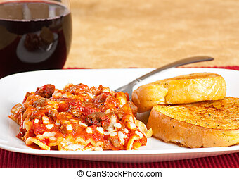 Lasagna Dinner - Lasagna with garlic toast and a glass of...