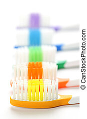 Toothbrushes - Close up of multicolored toothbrushes on...