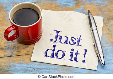 Just do it motivational advice on napkin with a cup of...