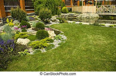 Garden Arbor - Arbor in garden with flowerbed, colorful...