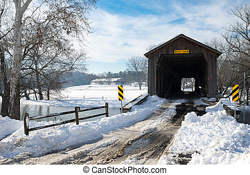 Old Covered Bridge - An old covered bridge on a snowy winter...