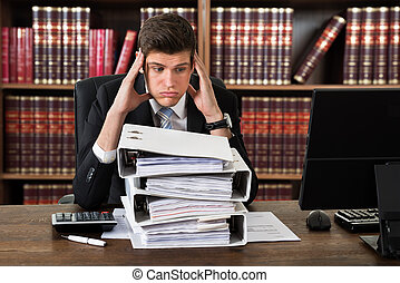 Stressed Attorney Looking At Heap Of Binders - Stressed...