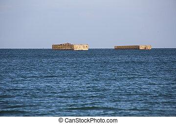 Entre Arromanches ey Asnelle - Ruins of harbor built by the...