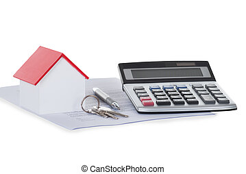 Calculator With House Model And Documents - Closeup of...