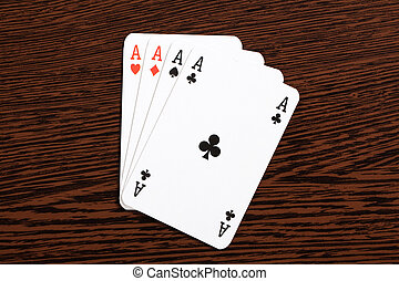 poker cards on table - the poker cards on wooden table