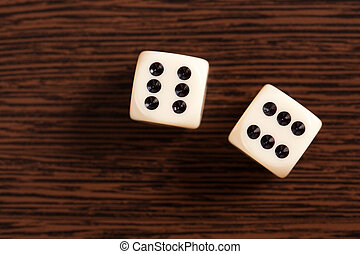 dice on wooden table - photo shot of dice on wooden table