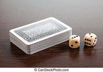 poker cards and dices on wooden table